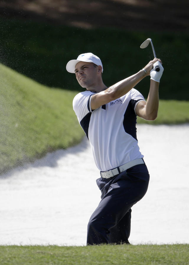 Martin Kaymer of Germany, watches his shot from a fourth fairway bunker during the first round of The Players championship golf tournament at TPC Sawgrass, Thursday, May 8, 2014 in Ponte Vedra Beach, Fla. (AP Photo/Lynne Sladky)
