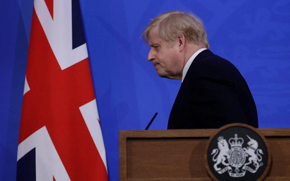 Boris Johnson leaves after giving an update on the coronavirus pandemic during a virtual press conference inside the new Downing Street Briefing Room in central London - Matt Dunham/AFP