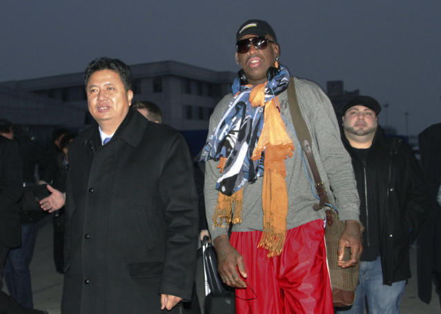 Former NBA basketball star Dennis Rodman walks with Vice Minister of North Korea's Sports Ministry, Son Kwang Ho, as Rodman arrives at the international airport in Pyongyang, North Korea on Thursday, Dec. 19, 2013. (AP Photo/Kim Kwang Hyon)