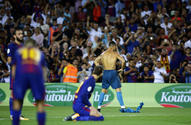 Real Madrid's Cristiano Ronaldo, right back, celebrates after scoring during the Spanish Supercup, first leg, soccer match between FC Barcelona and Real Madrid at the Camp Nou stadium in Barcelona, Spain, Sunday, Aug. 13, 2017. (AP Photo/Manu Fernandez)