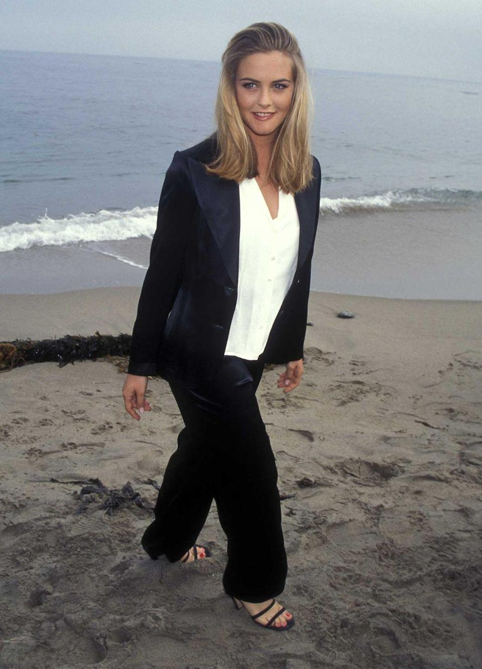 <p>Alicia Silverstone seen walking in the sand at the <em>Clueless</em> premiere, which took place on the beach in Malibu, California in 1995. </p>