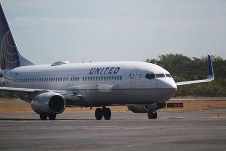 A United Airlines aircraft is seen at the Monsenor Oscar Arnulfo Romero International Airport in San Luis Talpa
