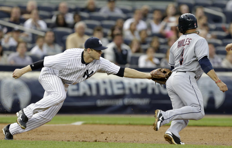 New York Yankees third baseman David Adams, left, tags out Cleveland Indians' Mike Aviles in a rundown on a ball hit by Nick Swisher during the third inning of a baseball game at Yankee Stadium in New York, Monday, June 3, 2013. (AP Photo/Kathy Willens)