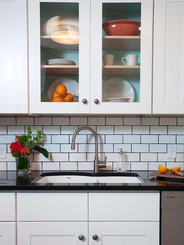 """<p>In keeping with the classic white subway tile backsplash, one way to add a bit of interest is by adding contrast with a dark grout, such as the deep gray featured here. Another bonus? A darker grout is excellent for hiding dirt! <b>RELATED: <a href=""""http://www.hgtv.com/design/rooms/kitchens/30-splashy-kitchen-backsplashes-pictures?oc=PTNR-YahooRealEstate-HGTV-subway_tile_twists"""" rel=""""nofollow noopener"""" target=""""_blank"""" data-ylk=""""slk:45 More Splashy Kitchen Backsplashes"""" class=""""link rapid-noclick-resp"""">45 More Splashy Kitchen Backsplashes</a></b></p>"""