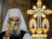 FILE - In this May 5, 2013, file photo, Serbian Orthodox Church Patriarch Irinej performs the traditional Orthodox Easter Liturgy in the St. Sava temple, in Belgrade, Serbia. The leader of the Serbian Orthodox Church, Patriarch Irinej, has died after testing positive for the coronavirus, the religious body said Friday, Nov. 20, 2020. He was 90.(AP Photo/Darko Vojinovic, File)