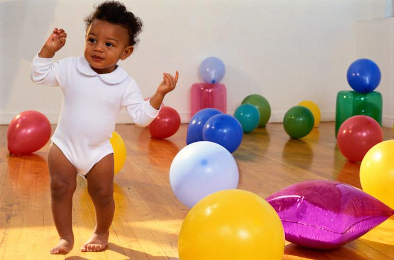 Toddler Surrounded by Balloons