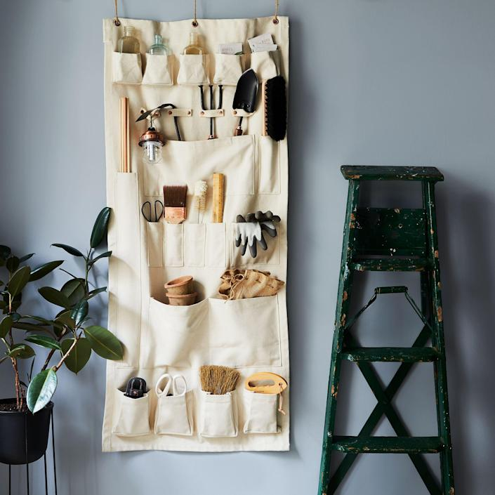 """<br><br><strong>The Floral Society</strong> Vertical Canvas Wall Organizer, $, available at <a href=""""https://go.skimresources.com/?id=30283X879131&url=https%3A%2F%2Ffood52.com%2Fshop%2Fproducts%2F4707-vertical-canvas-wall-organizer"""" rel=""""nofollow noopener"""" target=""""_blank"""" data-ylk=""""slk:Food52"""" class=""""link rapid-noclick-resp"""">Food52</a>"""