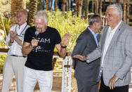 """Sir Richard Branson, second from left, founder of Virgin Group, laughs with Nevada Gov. Steve Sisolak during the """"Unstoppable Weekend"""" kickoff party at Virgin Hotels Las Vegas on Thursday, June 10, 2021. (Benjamin Hager/Las Vegas Review-Journal via AP)"""