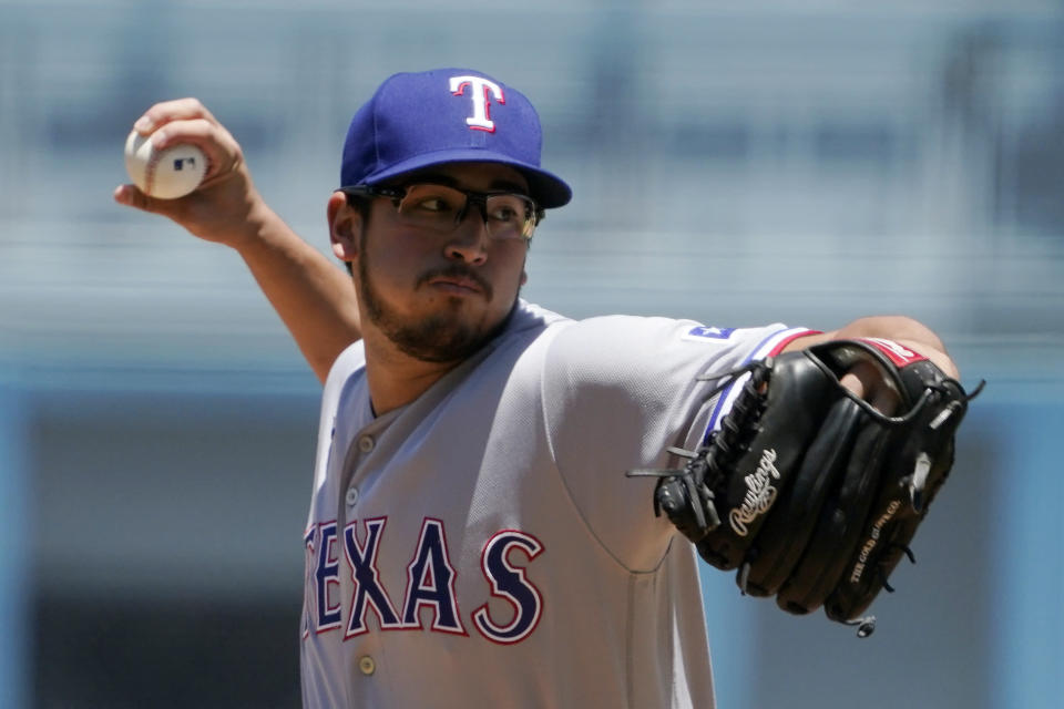 Texas Rangers starting pitcher Dane Dunning throws to the plate during the first inning of a baseball game against the Los Angeles Dodgers Sunday, June 13, 2021, in Los Angeles. (AP Photo/Mark J. Terrill)