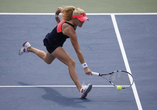 Agnieszka Radwanska of Poland hits a return to Anastasia Pavlyuchenkova of Russia at the U.S. Open tennis championships in New York August 30, 2013. REUTERS/Ray Stubblebine (UNITED STATES - Tags: SPORT TENNIS)