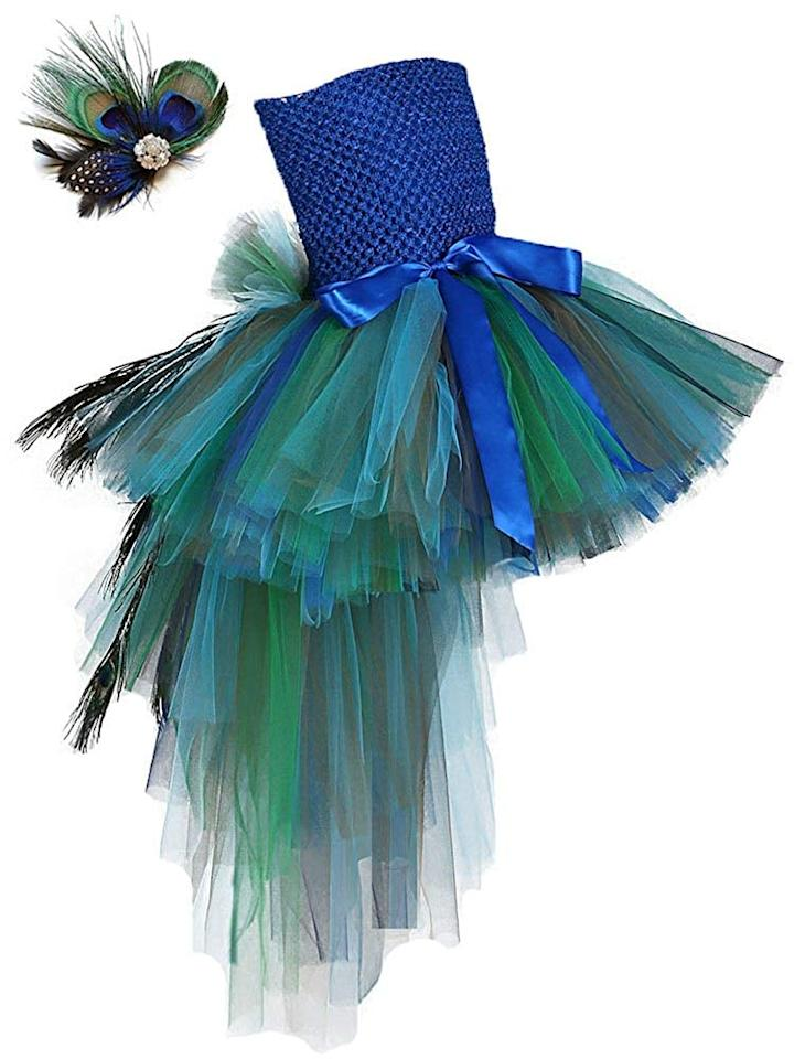 """<p>Order a fabulous <a href=""""https://www.popsugar.com/buy/Peacock-Dress-507391?p_name=Peacock%20Dress&retailer=amazon.com&pid=507391&price=68&evar1=moms%3Aus&evar9=32267581&evar98=https%3A%2F%2Fwww.popsugar.com%2Ffamily%2Fphoto-gallery%2F32267581%2Fimage%2F32267943%2FPeacock&list1=amazon%2Challoween%2Cfall%2Challoween%20costumes%2Ckid%20shopping%2Challoween%20for%20kids%2Ckid%20halloween%20costumes&prop13=api&pdata=1"""" rel=""""nofollow"""" data-shoppable-link=""""1"""" target=""""_blank"""" class=""""ga-track"""" data-ga-category=""""Related"""" data-ga-label=""""https://www.amazon.com/Tutu-Dreams-Fancy-Peacock-Costume/dp/B01GC2Z8YW/ref=sr_1_4?dchild=1&amp;keywords=peacock+kids+costume&amp;psc=1&amp;qid=1572037500&amp;sr=8-4"""" data-ga-action=""""In-Line Links"""">Peacock Dress</a> ($68) at the last second and prepare to wow other trick-or-treaters. </p>"""