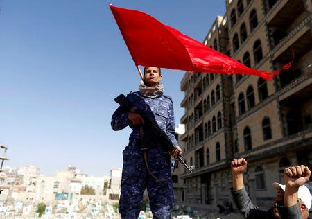 FILE PHOTO: A Shiite Houthi fighter stands guard at the site of a rally attended by fellows Houthis to mark the day of Ashura and the 4th anniversary of their takeover of the Yemeni capital, in Sanaa