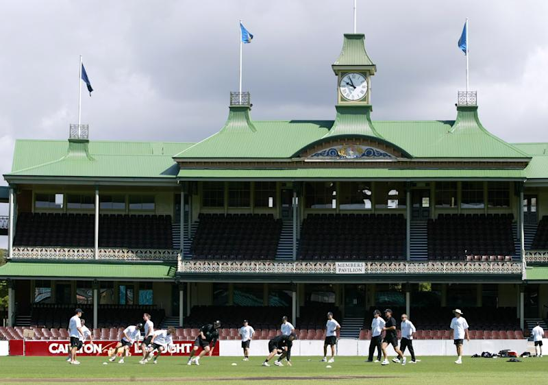 FILE - In this Nov. 10, 2004, file photo, members of the New Zealand cricket team go through warmup exercises in front of the members stand at the Sydney Cricket Ground in Sydney. The Los Angeles Dodgers and the Arizona Diamondbacks are scheduled to play a two-game series at the cricket ground on March 22 and 23, 2014, baseball's first regular-season games in Australia. (AP Photo/Mark Baker, File)