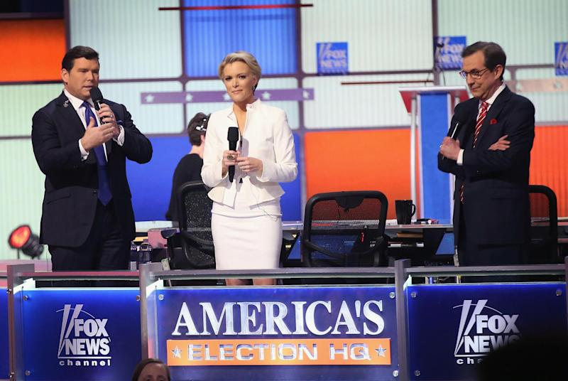 Moderators (Lto R) Bret Baier, Megyn Kelly and Chris Wallace are introduced at the Republican presidential debate sponsored by Fox News at the Fox Theatre on March 3, 2016 in Detroit, Michigan (Photo by Scott Olson/Getty Images)