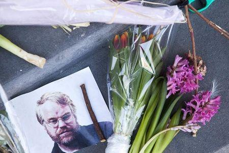 A photo of actor Phillip Seymour Hoffman sits on a makeshift memorial in front of his apartment building in the Manhattan borough of New York