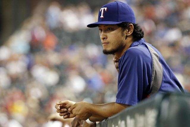 Texas Rangers starting pitcher Yu Darvish (11) looks on from the dugout during the eighth inning of a baseball game against the Tampa Bay Rays, Wednesday, Aug. 13, 2014, in Arlington, Texas. The Rangers announced before the start of the game that Darvish was placed on the 15-day disabled list with right elbow inflammation. Tampa Bay won 10-1. (AP Photo/Brandon Wade)