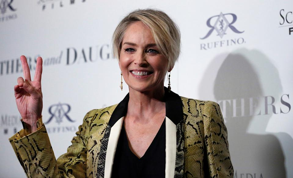 Cast member Sharon Stone poses at a premiere for