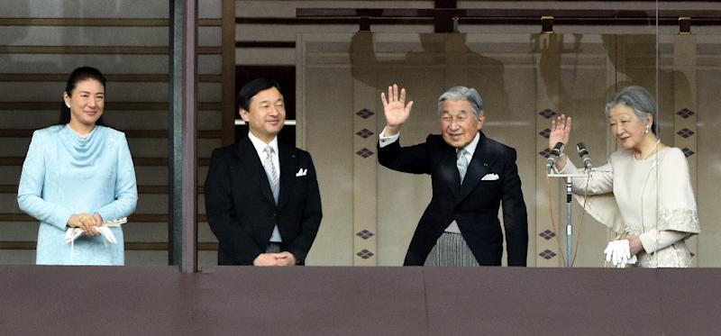 This January 2, 2015 file picture shows Japan's Emperor Akihito (2nd R) and Empress Michiko (R) waving to well-wishers while Crown Prince Naruhito (2nd L) and his wife Crown Princess Masako (L) look on during their new year greetings in Tokyo (AFP Photo/TOSHIFUMI KITAMURA)