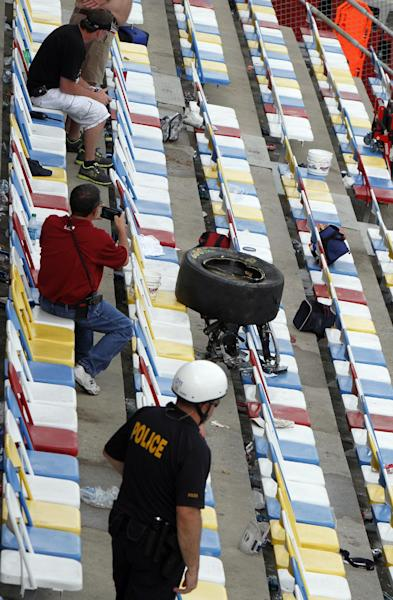 A tire rests in the stands after a crash at the conclusion of the NASCAR Nationwide Series auto race Saturday, Feb. 23, 2013, at Daytona International Speedway in Daytona Beach, Fla. Driver Kyle Larson's car hit the safety fence sending car parts and other debris flying into the stands injuring spectators. (AP Photo/David Graham)