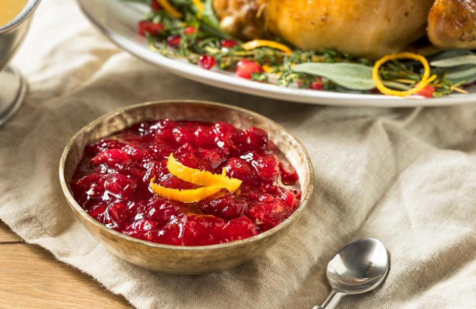 <p>If you're not that comfortable in the kitchen, being asked to bring a side to dinner can bring out a lot of anxiety. But there is no need to worry. One classic Thanksgiving side dish, cranberry sauce, is so easy to make from scratch and only requires three ingredients. The night before Thanksgiving, add 1 cup of orange juice and 1 cup of white sugar to a medium-sized saucepan and heat it at a medium temperature until the sugar is completely dissolved in the orange juice. Next, add in one 12-ounce bag of fresh cranberries and cook the berries until they start to pop (about 10-15 minutes), while gently stirring the sauce every few minutes. After that, remove the cranberry sauce from the stove, allow to cool and then place it in the fridge. This dish is simple and budget-friendly but fresh cranberry sauce is sure to impress your friends and family.</p>