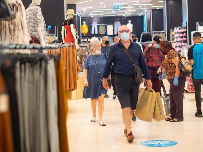 File photo of customers wearing face masks as they shop at Primark in Oxford Street, London: Victoria Jones/PA