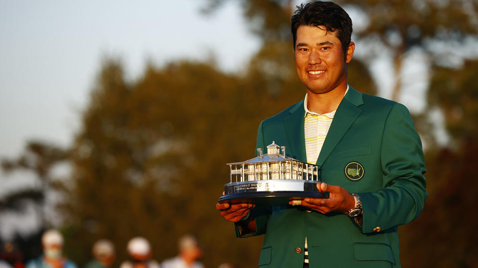 Hideki Matsuyama of Japan poses with the Masters Trophy during the Green Jacket Ceremony after winning the Masters at Augusta National Golf Club on April 11, 2021. (Photo by Jared C. Tilton/Getty Images)