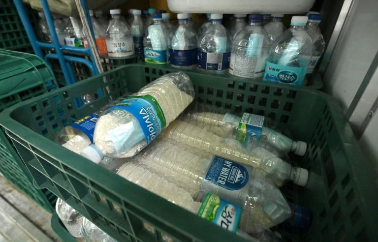 Plastic bottles filled with rice and face masks are pictured on June 18, 2020 in Seoul, loaded on the truck of a North Korean defector planning to send the bottles towards North Korea through a border river (AFP Photo/Jung Yeon-je)