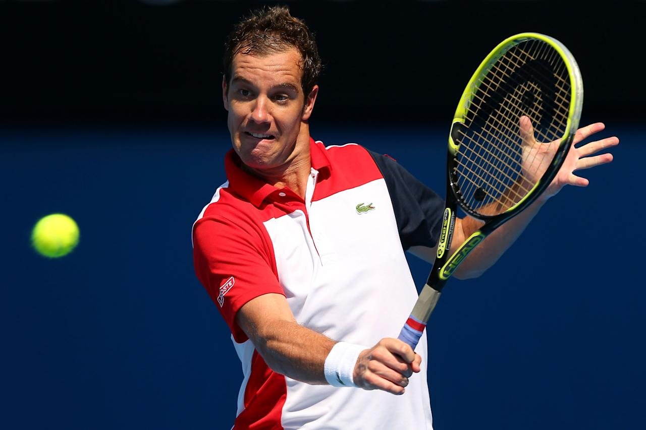 MELBOURNE, AUSTRALIA - JANUARY 21:  Richard Gasquet of France plays a backhand in his fourth round match against Jo-Wilfried Tsonga of France during day eight of the 2013 Australian Open at Melbourne Park on January 21, 2013 in Melbourne, Australia.  (Photo by Quinn Rooney/Getty Images)