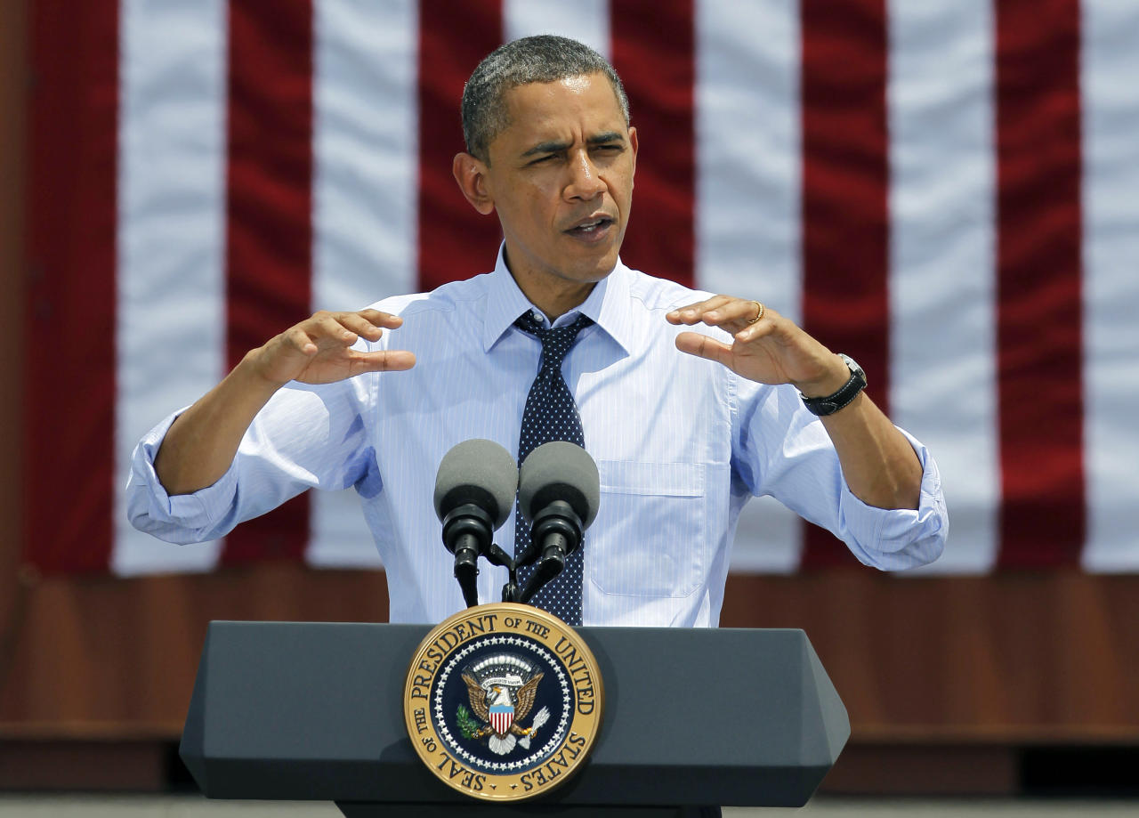 President Barack Obama speaks at the Port of Tampa in Tampa, Fla., ,Friday, April 13, 2012, about trade with Latin America before heading to Colombia for the Summit of the Americas. (AP Photo/Chris O'Meara)
