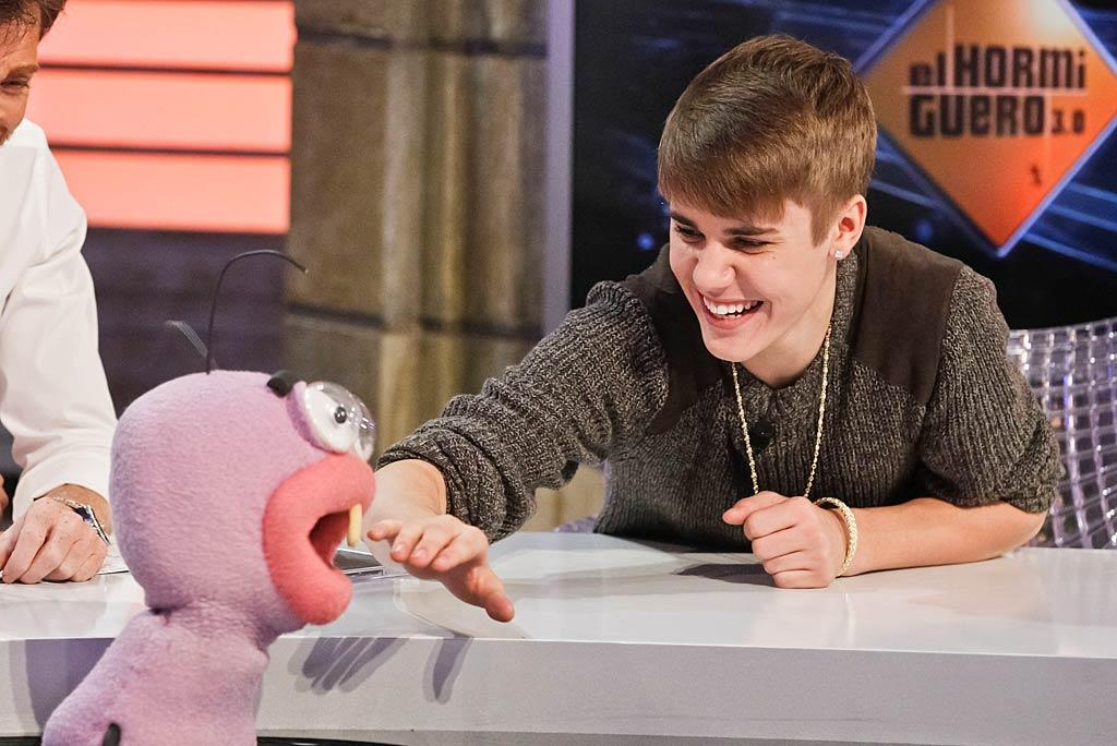 Meanwhile, the real Justin Bieber looked he was having fun on a talk show in Madrid Spain, on Wednesday. Hey, why don't American talk shows have fuzzy pink puppets? (11/16/2011)