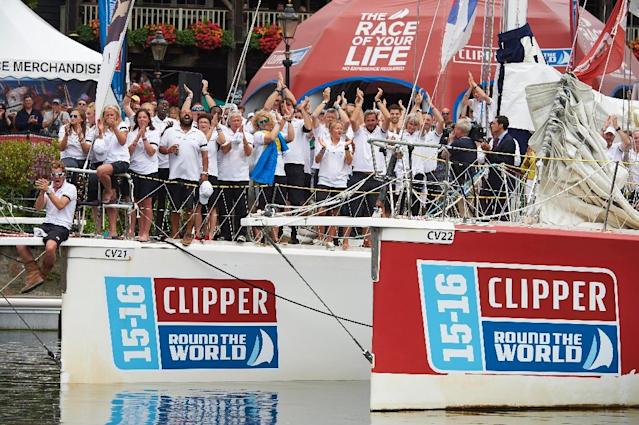 Crew members of Ichorcoal clap for one minute to commemorate two of their crew members, Andrew Ashman and Sarah Young, who both lost their lives during the 2015-16 Clipper Round the World Yacht Race during the prize ceremony July 30, 2016 (AFP Photo/NIKLAS HALLE'N)