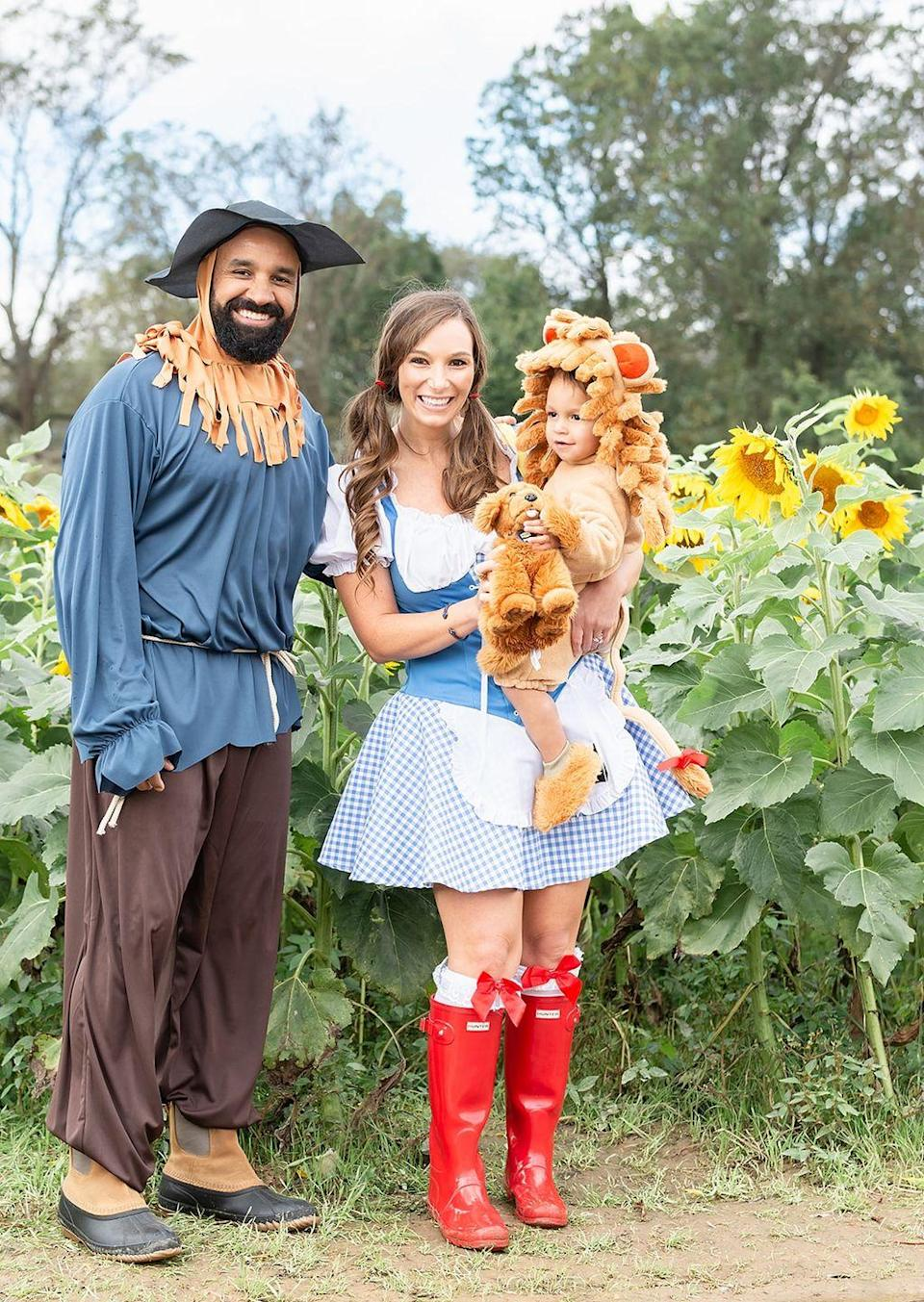 """<p>There may be no place like home, but you can still follow the yellow brick road to this sweet costume grouping, which brings together Dorothy, the Scarecrow, and the Cowardly Lion together. </p><p><strong>Get the tutorial at <a href=""""http://shoptini.com/fashion/top-ten-last-minute-halloween-costume-ideas/"""" rel=""""nofollow noopener"""" target=""""_blank"""" data-ylk=""""slk:Shoptini"""" class=""""link rapid-noclick-resp"""">Shoptini</a>. </strong></p><p><a class=""""link rapid-noclick-resp"""" href=""""https://www.amazon.com/Hunter-Womens-Original-Gloss-Military/dp/B00K1XCRG6/ref=sr_1_2?dchild=1&tag=syn-yahoo-20&ascsubtag=%5Bartid%7C10050.g.29074815%5Bsrc%7Cyahoo-us"""" rel=""""nofollow noopener"""" target=""""_blank"""" data-ylk=""""slk:SHOP RED BOOTS"""">SHOP RED BOOTS</a><br></p>"""