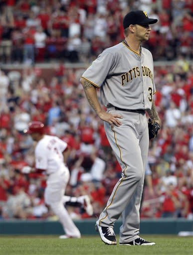 Pittsburgh Pirates starting pitcher A.J. Burnett, right, walks off the mound as St. Louis Cardinals' Carlos Beltran rounds the bases after hitting a three-run home run during the first inning of a baseball game Wednesday, May 2, 2012, in St. Louis. (AP Photo/Jeff Roberson)