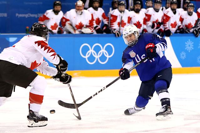 <p>Jocelyne Lamoureux #17 of the United States shoots the puck around Lauriane Rougeau #5 of Canada in overtime during the Women's Gold Medal Game on day thirteen of the PyeongChang 2018 Winter Olympic Games at Gangneung Hockey Centre on February 22, 2018 in Gangneung, South Korea. (Photo by Jamie Squire/Getty Images) </p>