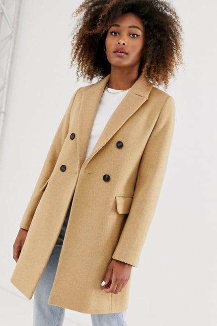 """<p>There is nothing more classic than a double-breasted camel coat like this one from Stradivarius.<br><a href=""""https://www.popsugar.com/buy/Stradivarius-Double-Breasted-Tailored-Coat-517895?p_name=Stradivarius%20Double-Breasted%20Tailored%20Coat&retailer=asos.com&pid=517895&price=90&evar1=fab%3Aus&evar9=46902505&evar98=https%3A%2F%2Fwww.popsugar.com%2Ffashion%2Fphoto-gallery%2F46902505%2Fimage%2F46902506%2FStradivarius&prop13=mobile&pdata=1"""" rel=""""nofollow"""" data-shoppable-link=""""1"""" target=""""_blank"""" class=""""ga-track"""" data-ga-category=""""Related"""" data-ga-label=""""https://www.asos.com/us/stradivarius/stradivarius-double-breasted-tailored-coat-in-camel/prd/13121198?clr=camel&amp;colourWayId=16463553&amp;SearchQuery=&amp;cid=11893"""" data-ga-action=""""In-Line Links"""">Stradivarius Double-Breasted Tailored Coat</a> ($90)</p>"""