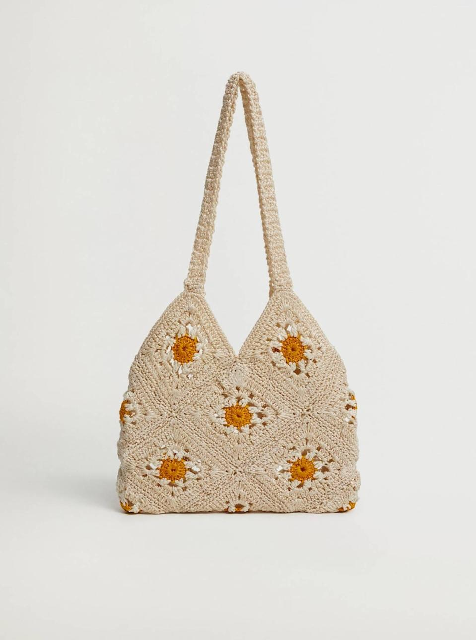 """To start out on a subtle note, let's take a moment to admire this beige-and-gold crochet bag that'll pair perfectly with all of your favorite <a href=""""https://www.glamour.com/gallery/things-to-buy-through-glamour-rewards?mbid=synd_yahoo_rss"""" rel=""""nofollow noopener"""" target=""""_blank"""" data-ylk=""""slk:nap dresses"""" class=""""link rapid-noclick-resp"""">nap dresses</a>. $40, Mango. <a href=""""https://shop.mango.com/us/women/bags-handbags/floral-crochet-bag_87074753.html"""" rel=""""nofollow noopener"""" target=""""_blank"""" data-ylk=""""slk:Get it now!"""" class=""""link rapid-noclick-resp"""">Get it now!</a>"""