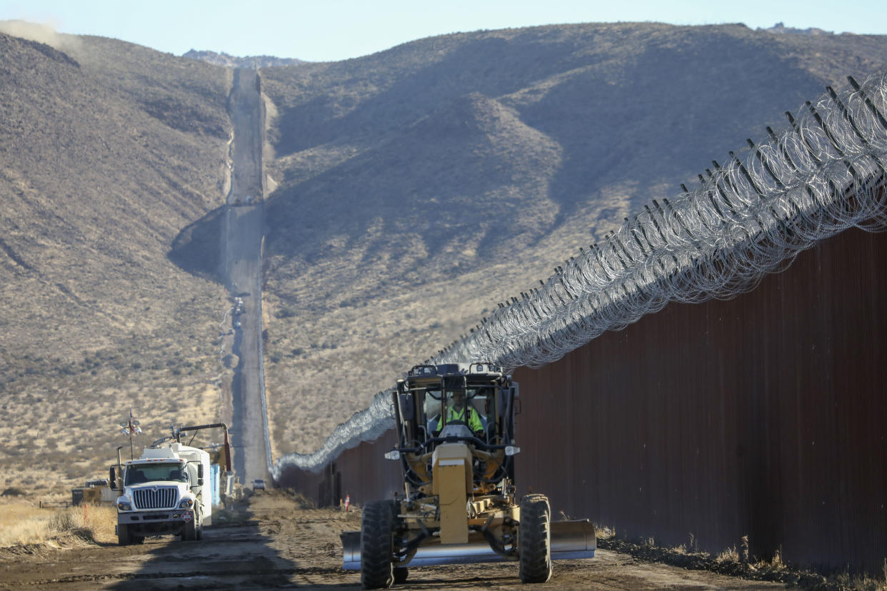 JACUMBA, CA - DECEMBER 01: Construction crews work on the United States-Mexico border wall on December 1, 2020 in Jacumba, California. President-elect Joe Biden wants to stop construction of the border wall, but the departing Trump administration is rushing to complete as much wall as possible in its last weeks in power. (Photo by Sandy Huffaker/Getty Images)