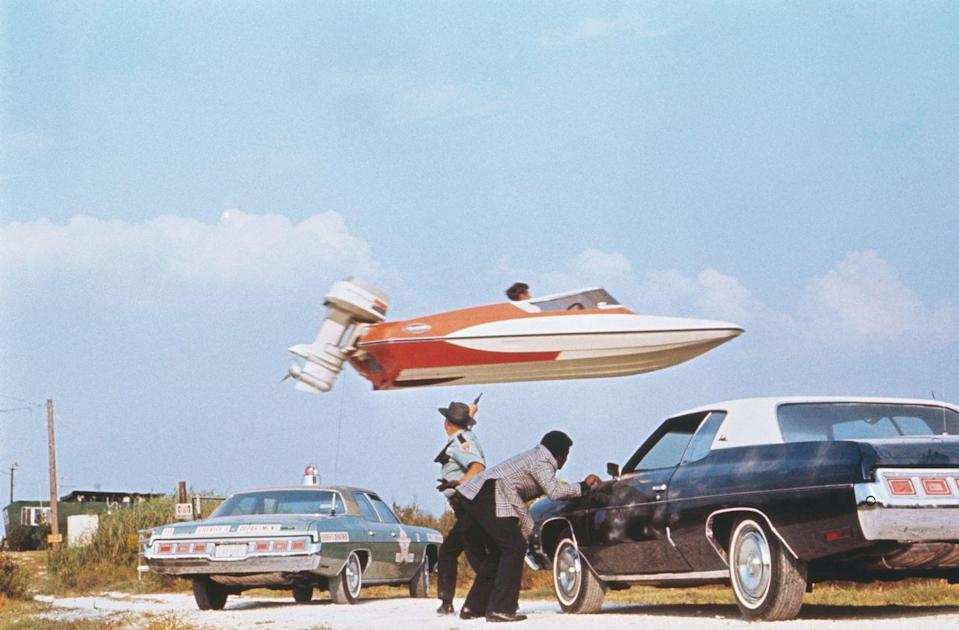 <p>Stunt performer Jerry Comeaux jumps a Glaston GT-50 speedboat over police officers and their squads as part of an escape scene from Live and Let Die.</p>