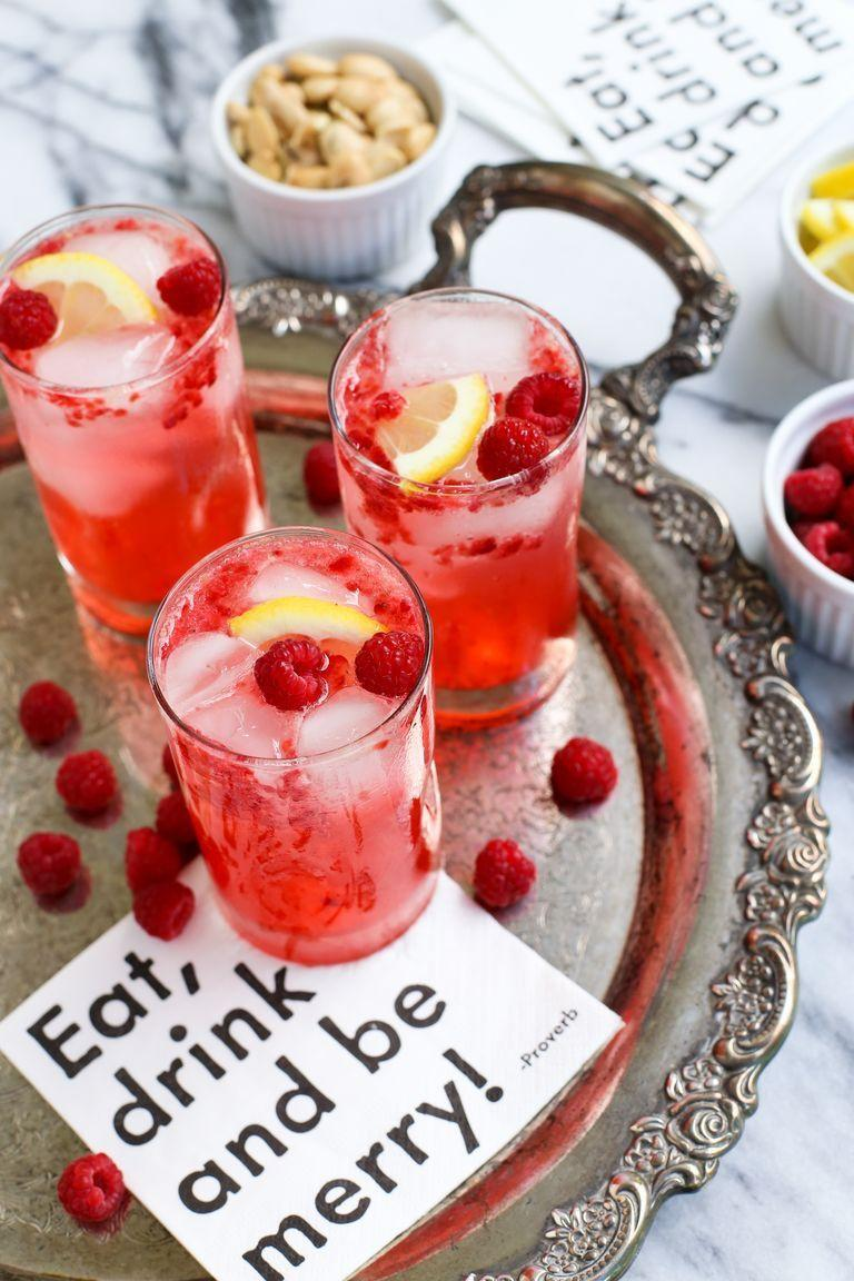 """<p>This fruity and herbaceous cocktail is sure to be a smash at your 4th of July bash. </p><p><strong><em>Get the recipe at <a href=""""https://www.thepioneerwoman.com/food-cooking/recipes/a78045/raspberry-smash/"""" rel=""""nofollow noopener"""" target=""""_blank"""" data-ylk=""""slk:The Pioneer Woman"""" class=""""link rapid-noclick-resp"""">The Pioneer Woman</a>. </em></strong></p>"""