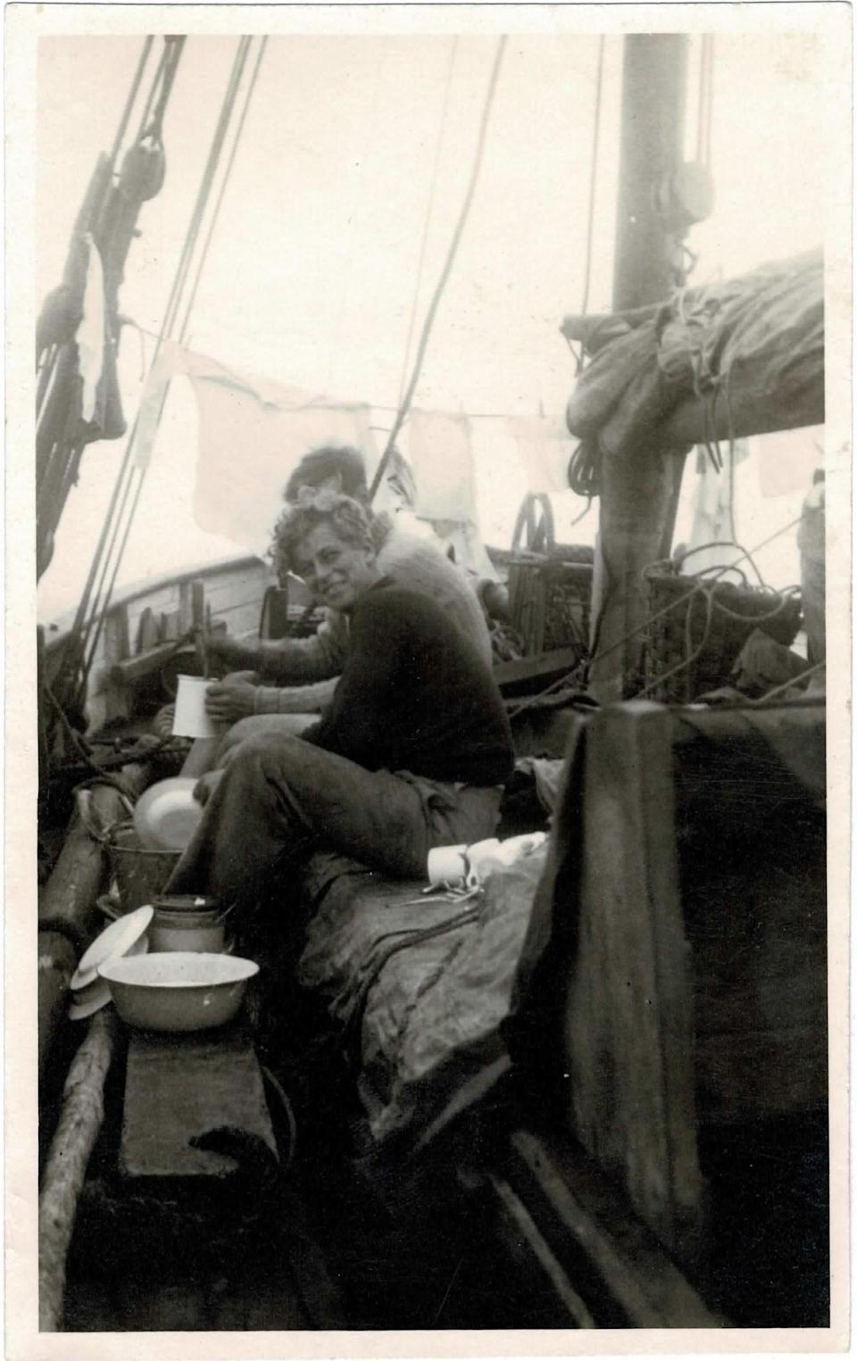 A teenage Philip grins while washing up aboard the school vessel (Major B Varvill R.A.M.C/PA)