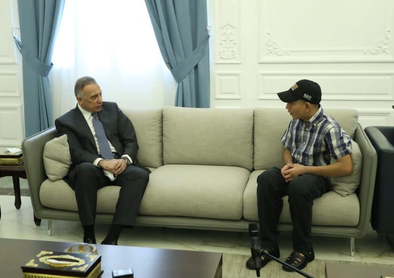 Iraqi Prime Minister Mustafa al-Kadhimi meets with Iraqi teenager Hamid Saeed, who was mistreated by members of security forces, after he was released from jail in Baghdad