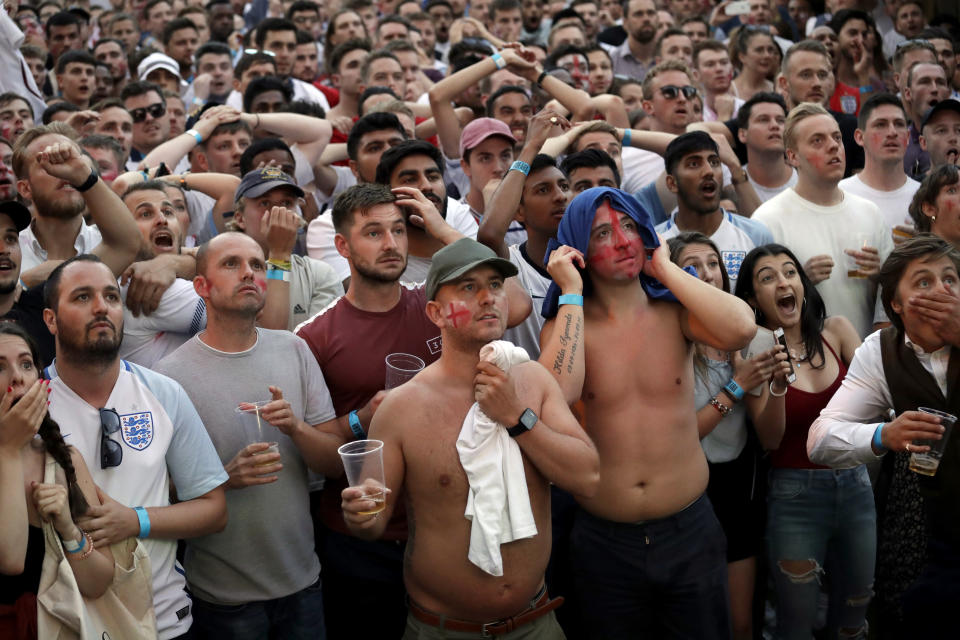 <p>England fans in south London react in frustration as Colombia score to make it 1-1 </p>