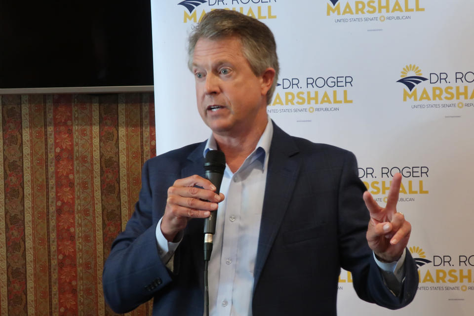 FILE - U.S. Rep. Roger Marshall, R-Kan., speaks to a local Elephant Club meeting in the banquet room of a restaurant in Overland Park, Kan. on Aug. 18, 2020. Marshall and Democrat state Sen. Barbara Bollier will meet in their first debate of their race to replace retiring Sen. Pat Roberts. (AP Photo/John Hanna, File)