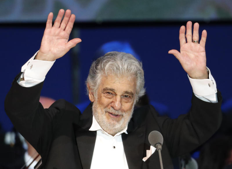 """FILE - In this Aug. 28, 2019, file photo, Opera star Placido Domingo performs during a concert in Szeged, Hungary. The 78-year-old singer who rose to stardom as a tenor has been confirmed to sing the baritone title role in """"Nabucco"""" at the Zurich Opera House this Sunday. It will be his first time performing since stepping down Oct. 2 as general director of the Los Angeles Opera and withdrawing from future performances at the company.(AP Photo/Laszlo Balogh, File)"""