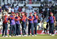 England players celebrate their win in the second Twenty20 international cricket match against Pakistan at Headingley in Leeds, Sunday, July 18, 2021. (AP Photo/Rui Vieira)