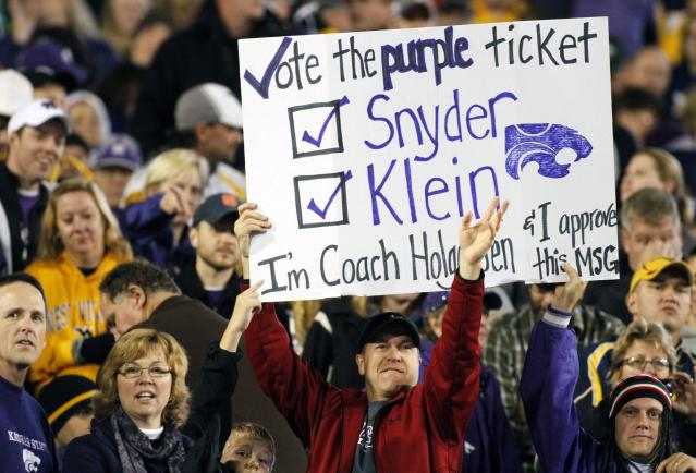 MORGANTOWN, WV - OCTOBER 20: Kansas State Wildcat fans cheer against the West Virginia Mountaineers during the game on October 20, 2012 at Mountaineer Field in Morgantown, West Virginia. (Photo by Justin K. Aller/Getty Images)