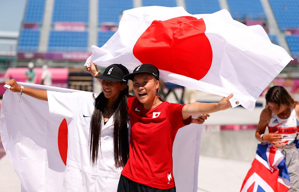 TOKYO, JAPAN - AUGUST 04: Sakura Yosozumi of Team Japan and Kokona Hiraki of Team Japan celebrate after winning the Gold and Silver medals respectively during the Women's Skateboarding Park Finals on day twelve of the Tokyo 2020 Olympic Games at Ariake Urban Sports Park on August 04, 2021 in Tokyo, Japan. (Photo by Ezra Shaw/Getty Images)