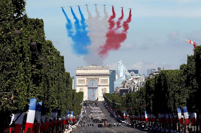 <p>Alpha jets from the French Air Force Patrouille de France fly over the Champs-Elysees avenue during the traditional Bastille Day military parade in Paris, France, July 14, 2017. (Photo: Gonzalo Fuentes/Reuters) </p>