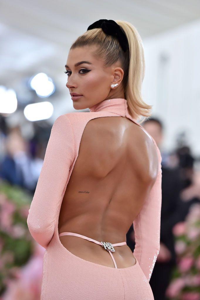 <p>Bieber has two phrases inked on her back courtesy of her go-to artist Jon Boy Tattoo. First there is the French phrase, 'coeur d'Alene' which translates to 'Alene's heart'. Alene is reportedly her sister Alaia's middle name. </p><p>The second tattoo is intricate writing down her spine, which has the word 'Unseen' inscribed, which is reportedly connected to a bible verse. </p>