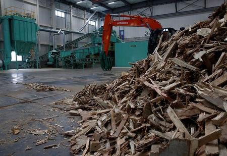 Collected wooden construction wastes are seen at Eco Green Holdings's factory which makes wood chips from construction waste in Tokyo, Japan September 7, 2017. Picture taken September 7, 2017  REUTERS/Kim Kyung-Hoon